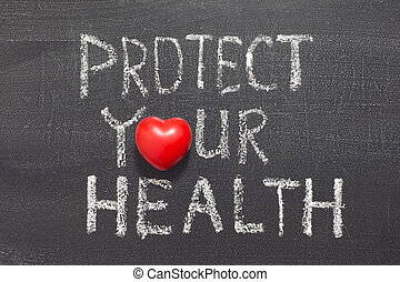 protect your health concept phrase handwritten on the blackboard