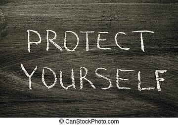 protect yourself phrase handwritten on school blackboard