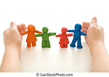 Hands protecting colorful clay people family - on white