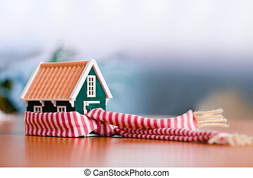 Protecting your house - Scarf around a miniature green house...