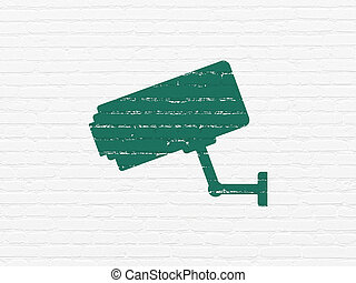 Protection concept: Cctv Camera on wall background