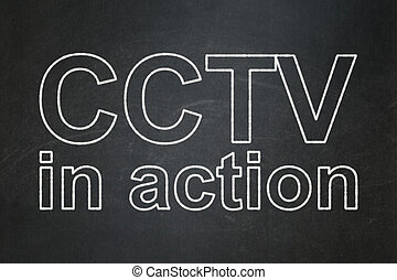 Protection concept: CCTV In action on chalkboard background