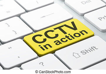 Protection concept: CCTV In action on computer keyboard background
