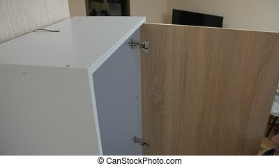 Protection furniture tip over man opens a wardrobe