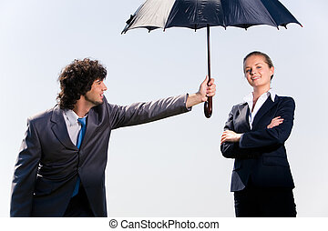 Protection - Photo of confident man protecting his coworker...