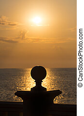 support with sphere against sea sunset