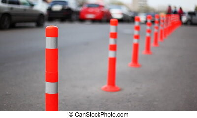 protective barrier made of striped columns, people and cars...