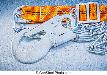 Protective construction strap on scratched metallic background