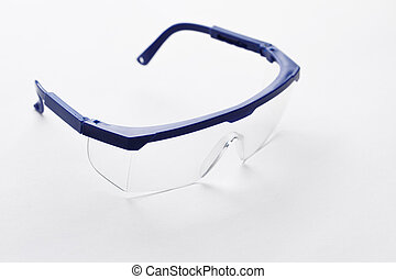 Protective glasses with transparent lenses on pure white...