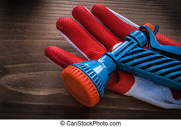 Protective glove and garden water pistol agriculture concept