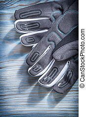 Protective gloves on wooden board gardening concept