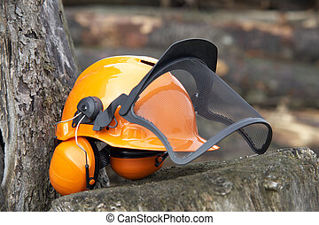 protective helmet outdoor shot - orange protective helmet...