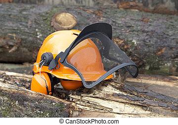 protective helmet outdoor shot - orange protective helmet...