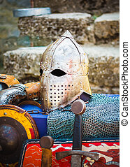 Protective helmet with a visor on medieval knight -...