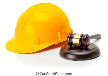 Protective helmet with wooden judge gavel near it - Yellow...