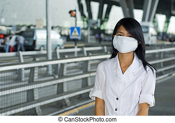 protective mask on young asian woman - asian woman standing...