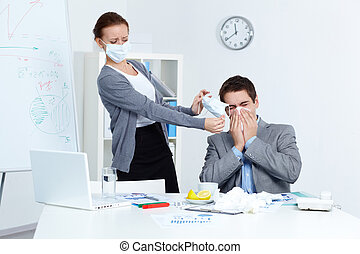 Protective measures - Image of businessman sneezing while...