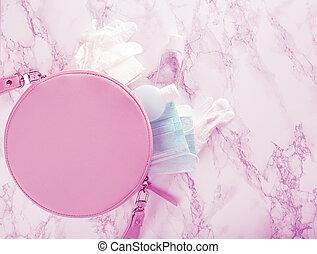 protective medical mask, sanitizer gel and gloves in pink ...