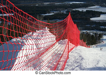 Protective red grid on a mountain-skiing line