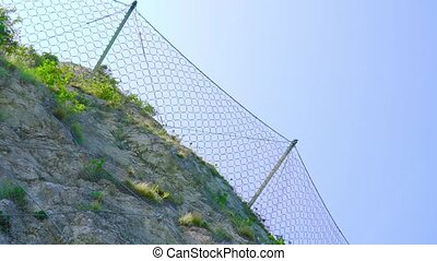 Protective wire mesh on the rock mountains