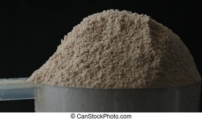 Protein powder in scoop, close up