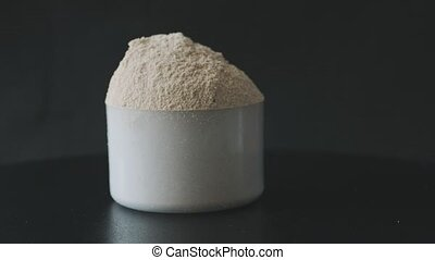whey protein in scoop on black
