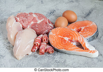Proteins and fats. Pork, chicken, bacon, eggs, fish salmon. ...