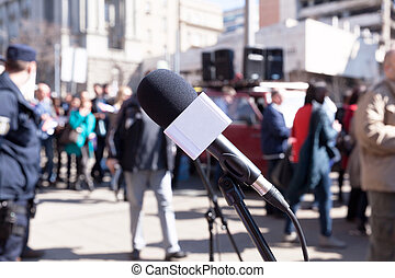 Protest. Demonstration. Microphone in focus, blurred...
