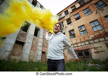 Protest - Portrait of furious dude with smoking detonator...