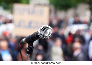 Protest. Public demonstration. Microphone. - Microphone in...