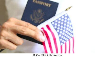 Proud american. US passport and flag. Passport check