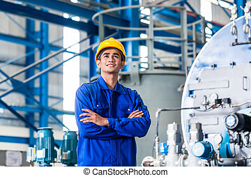 Proud Asian worker in production factory - Proud Asian...