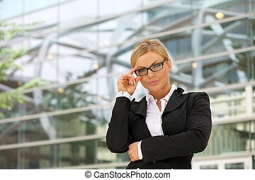 Proud business woman in glasses