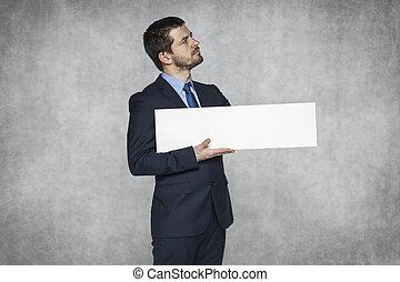 proud businessman holding advertisement