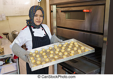 proud chef with her pastry baking