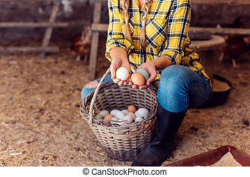 Proud chicken farmer showing the eggs her hens produced
