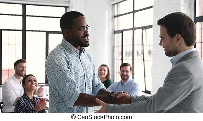 Proud confident african male professional get promoted handshake boss