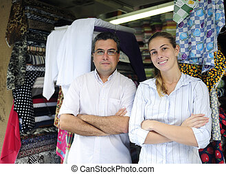 family business partners owners of a fabric store - proud...