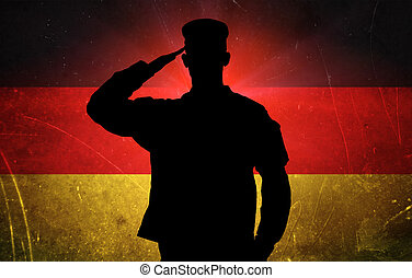 Proud german soldier on german flag background