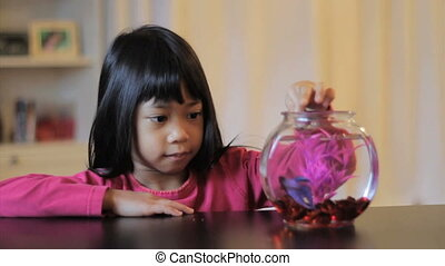 Proud Girl Feeds Her Betta Fish - A cute little 5 year old...