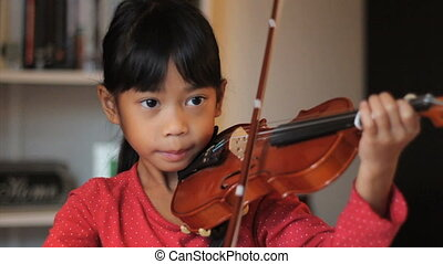 Proud Girl Practising Her Violin - A pretty 6 year-old Asian...