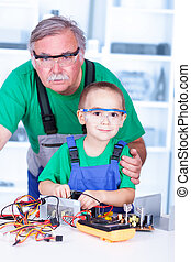 Proud grandfather with grandchild in workshop