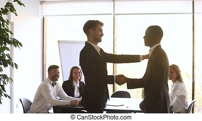 Proud happy african employee get promoted rewarded by manager handshake
