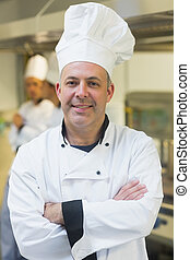 Proud mature chef posing in a kitc - Proud mature chef...