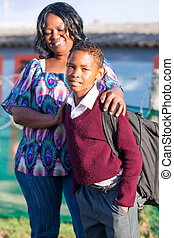 proud mother - an young african boy in his school clothes...