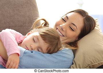 Proud mother watching her baby sleeping