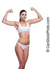 Proud of her fit body. Beautiful young woman in white bra ...