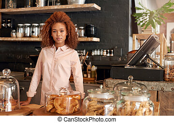 Proud owner of her own cafe