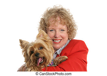 Proud Pet Owner - A pretty red-haired woman holding her...