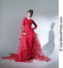 Proud red queen in fashion pose